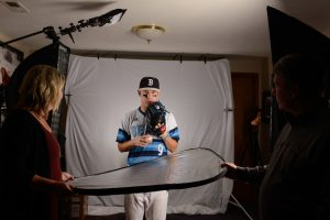 high school pitcher, strobes on both sides of him with a reflector underneath