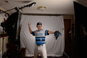 high school pitcher with arm back ready to pitch the baseball