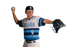high school pitcher ready to pitch, masked out from background